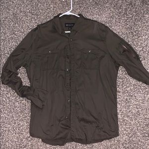 Army green button down shirt. Size: Large.